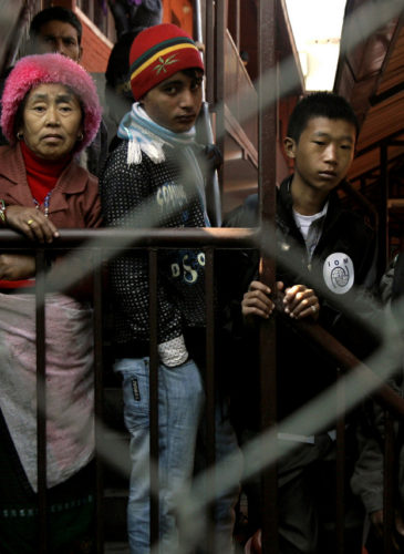 Bhutanese refugees wait to leave for resettlement abroad at a transit facility of International Organization for Migration in Katmandu, Nepal, Dec. 13, 2010. (AP/Binod Joshi)