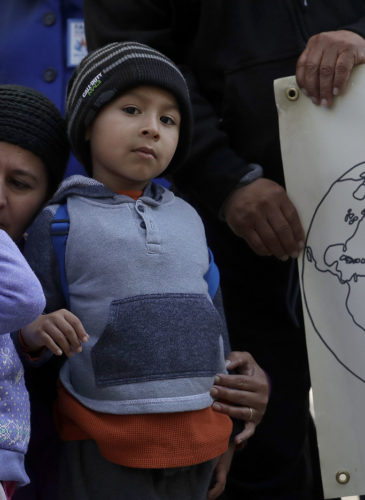Angela Henriquez, second from left, hugs her children Jessica, left, and Fernando as they listen to speakers at a news conference announcing a lawsuit against the Trump administration over its decision to end a program that lets immigrants live and work legally in the United States outside of a federal courthouse in San Francisco, March 12, 2018. Plaintiffs are alleging the decision to end temporary protected status for El Salvador, Haiti, Nicaragua and Sudan was racially motivated. (AP/Jeff Chiu)