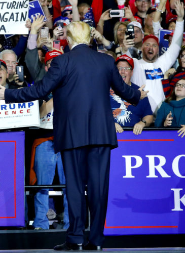 President Donald Trump stops to look at supporters as he introduced at a rally at Total Sports Park, April 28, 2018, in Washington, Mich. AP | Pablo Martinez Monsivais